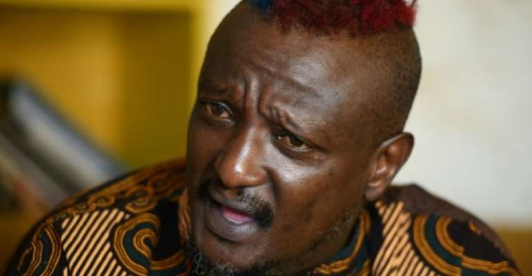 Binyavanga Wainaina, pictured in an AFP interview in January 2014, shortly after he declared that he was gay.  By SIMON MAINA (AFP)