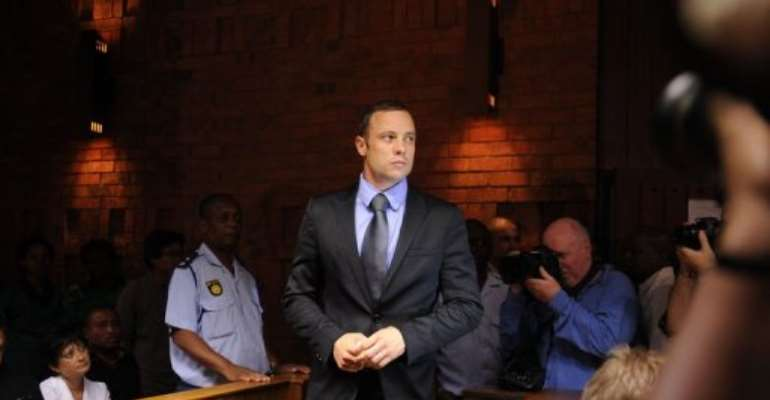 South African Olympic sprinter Oscar Pistorius appears on February 21, 2013 at the Magistrate Court in Pretoria.  By Alexander Joe (AFP)