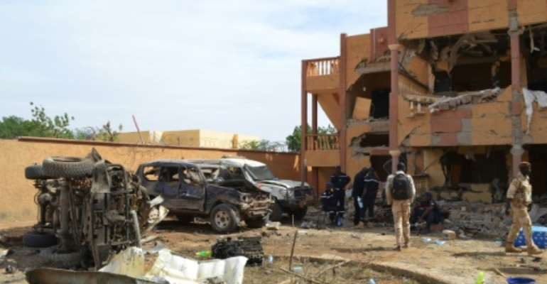 Blast: Aftermath of a suicide car bomb in Gao, northern Mali, last November that targeted a residential area used by UN sub-contractors. Three civilians were killed and around 30 were injured.  By STR (AFP)