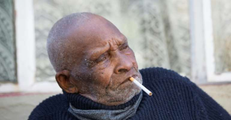 Blom was born in 1904 in the rural town of Adelaide and despite his great age still enjoys a cigarette.  By RODGER BOSCH (AFP)
