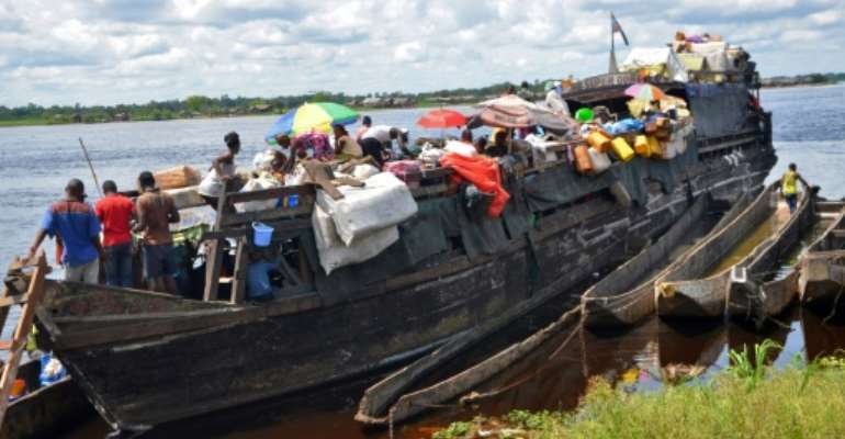 Boat accidents are common in the vast country, typically caused by overloading of passengers and cargo.  By Junior KANNAH (AFP/File)