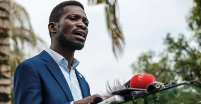 Bobi Wine, pictured last Friday at a press conference at his home in Magere, on the outskirts of Kampala.  By Sumy SADRUNI (AFP)