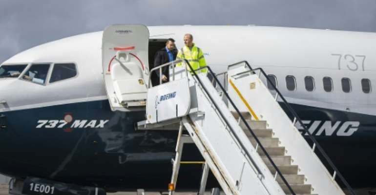 Boeing Chief Executive Dennis Muilenburg deplaning a Boeing 737 MAX after a test flight of the company's proposed fix to its anti-stall system.  By Marian Lockhart (BOEING/AFP)