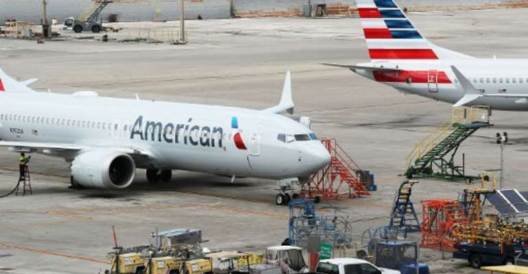Boeing's global fleet of 737 MAX planes has been grounded following recent accidents, including planes owned by American Airlines that were photographed last week.  By JOE RAEDLE (GETTY IMAGES NORTH AMERICA/AFP/File)