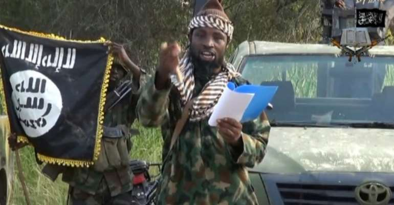 A video image of Abubakar Shekau, leader of the Nigerian Islamist extremist group Boko Haram, which has carried out deadly attacks in the country's northeast as well as parts of Cameroon, Niger and Chad.  By - (Boko Haram/AFP/File)