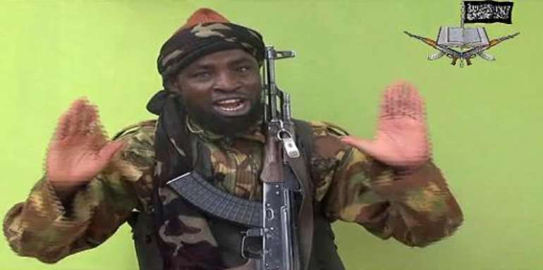 A screengrab taken on May 12, 2014, from a video released by Nigerian Islamist extremist group Boko Haram shows a man claiming to be the leader of the group.  By  (BOKO HARAM/AFP)