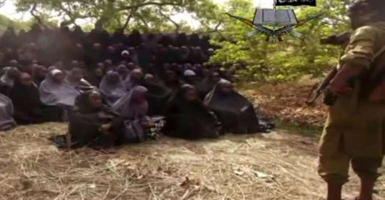Boko Haram fighters kidnapped 276 schoolgirls in 2014 as they were preparing for end-of-year exams in the remote northeastern town of Chibok.  By Ho (Boko Haram/AFP/File)