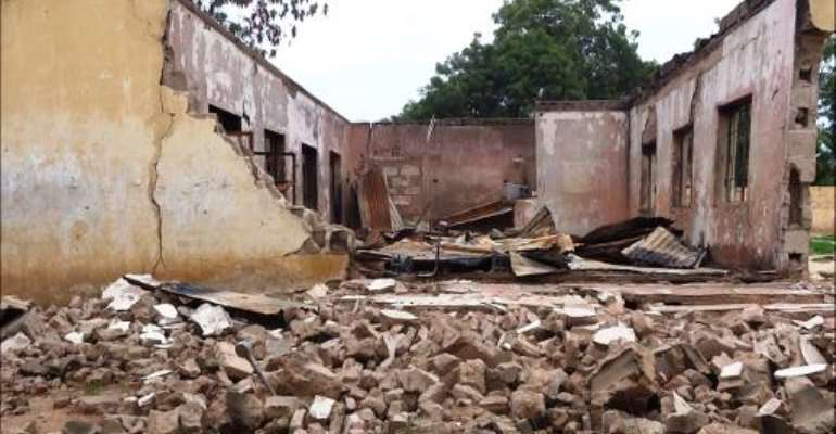 This picture taken on August 6, 2013 shows a blown up students hostel in the Government Secondary School of Mamudo, in the northeastern Nigerian Yobe state, after an attack by Boko Haram gunmen.  By Aminu Abubakar (AFP/File)