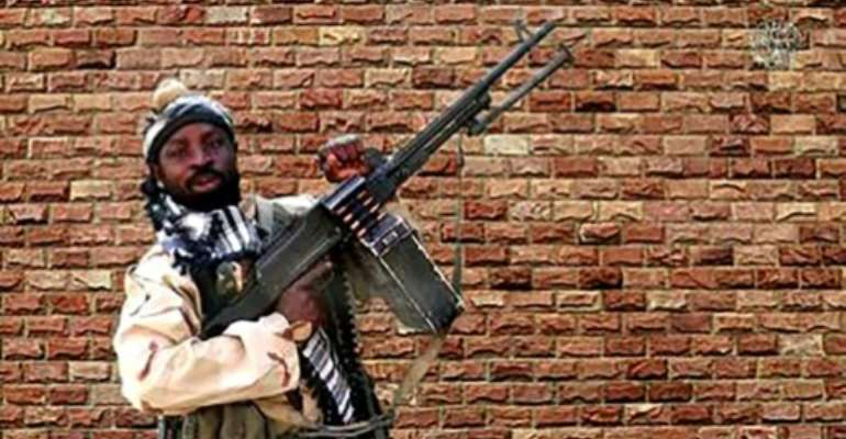 Boko Haram was dealt a devastating blow this year when its leader Abubakar Shekau, seen here in an image taken from a 2018 video, died during fighting with rival jihadists.  By Handout (BOKO HARAM/AFP)