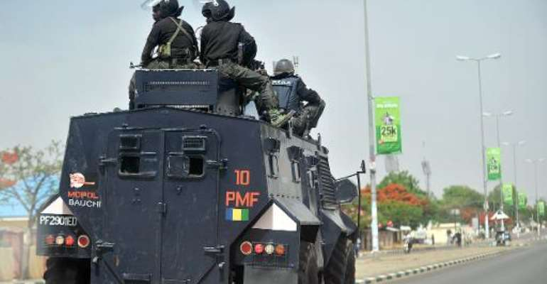 File photo of Nigerian police on patrol in the capital of Bauchi state, where a bomb blast at a bus station killed five people on October 23, 2014.  By Tony Karumba (AFP/File)