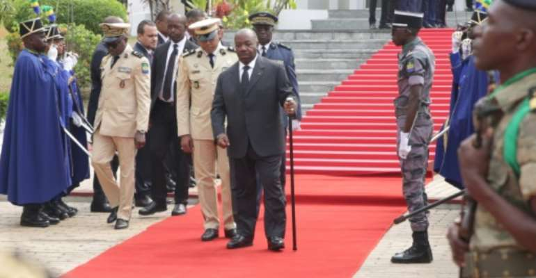 Bongo, centre, pictured at ceremonies in Libreville on August 16 ahead of Gabon's independence day celebrations.  By STEVE JORDAN (AFP/File)