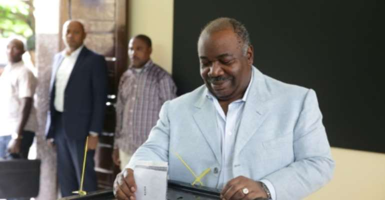 Bongo is shown casting his ballot on Saturday. Gabon has been ruled by the same political dynasty for nearly half a century.  By Joel TATOU (AFP)