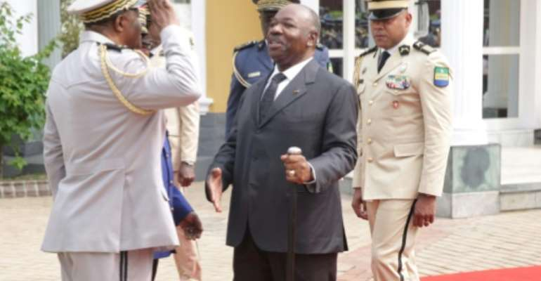 Bongo, seen here at a wreath-laying ceremony on August 16, sparked intense speculation about his fitness to govern after he fell ill with a stroke. He is scheduled to host an 11-nation regional summit on Wednesday.  By STEVE JORDAN (AFP/File)