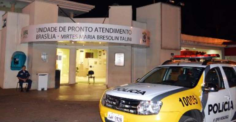 Police in Cascavel, Brazil on October 10, 2014, guard the entrance to the clinic where a Guinean patient suspected of having contracted Ebola was admitted when he had the first symptoms.  By Luiz Carlos Cruz (AFP/File)