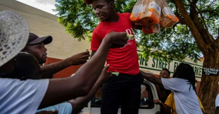 Bread is a main staple but prices shot up over night as bakers struggle with costs and shortages.  By ZINYANGE AUNTONY (AFP)