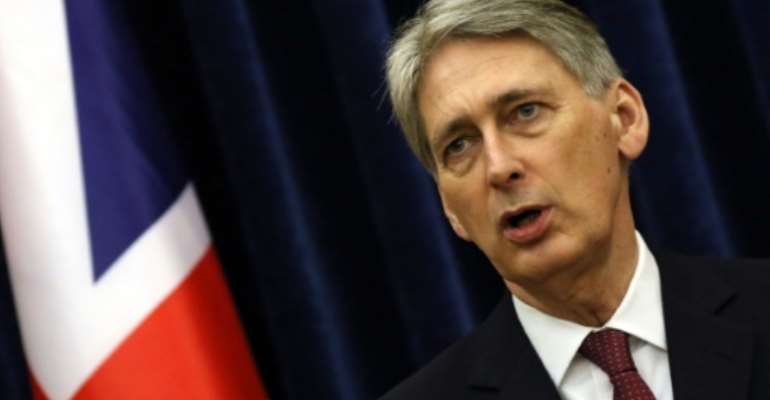 British Foreign Minister Philip Hammond is expected to meet Libyan officials after arriving in Tripoli on an unannounced visit.  By Safin Hamed (AFP/File)