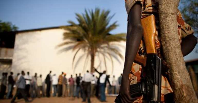 Southern Sudanese police stand guard outside a polling station in Juba on January 9, 2011.  By Trevor Snapp (AFP/File)