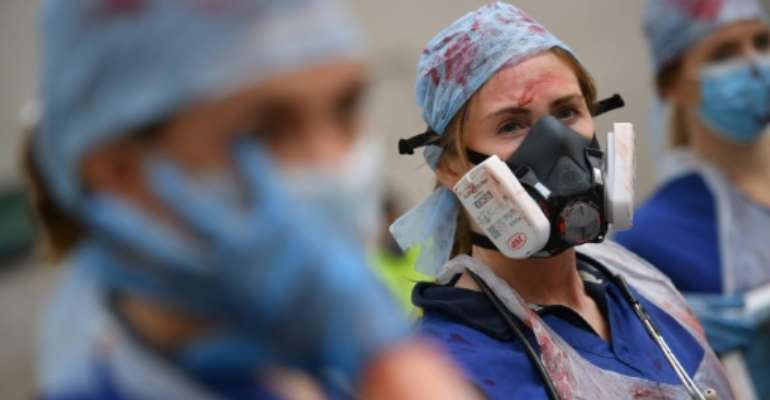 British nurses demonstrated in London for higher pay on Saturday.  By JUSTIN TALLIS (AFP/File)