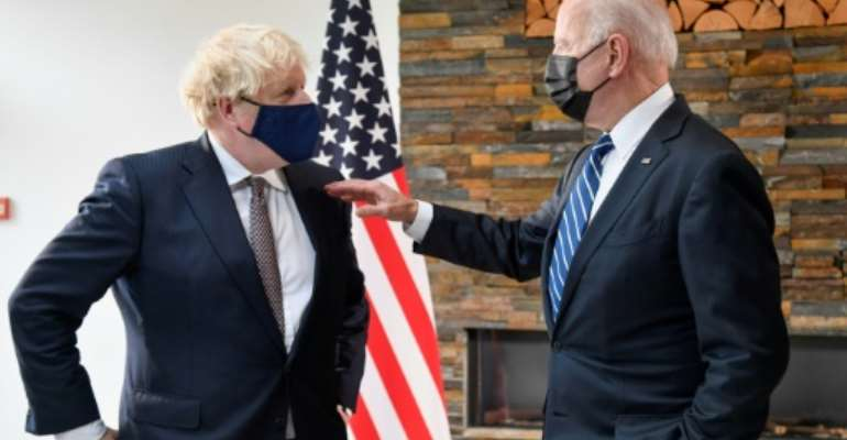 British PM Boris Johnson (L) spoke of the 'indestructible relationship' between the UK and US as he hosted President Joe Biden (R).  By TOBY MELVILLE (POOL/AFP)