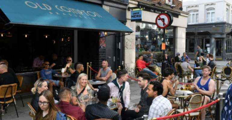 British pubs may be forced to close earlier.  By DANIEL LEAL-OLIVAS (AFP/File)