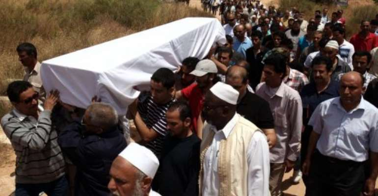 The coffin of Abdelbaset Ali Mohmet al-Megrahi is carried on on May 21, 2012 in Libya.  By Mahmud Turkia (AFP/File)