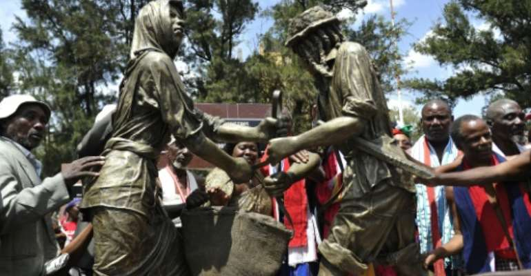 Kenyans attend the unveiling of the memorial dedicated to the thousands killed, tortured and jailed in the Mau Mau rebellion, during a ceremony in Nairobi, on September 12, 2015.  By Simon Maina (AFP)