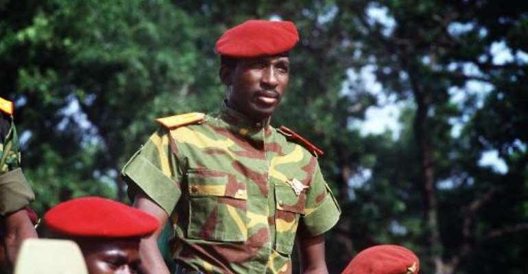 President Thomas Sankara reviews the troops in Ouagadougou on August 4, 1985.  By Daniel Laine (AFP/File)