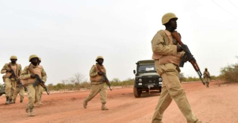 Burkina Faso armed forces, seen here in training, have suffered deadly attacks since the insurgency began in 2015.  By ISSOUF SANOGO (AFP)