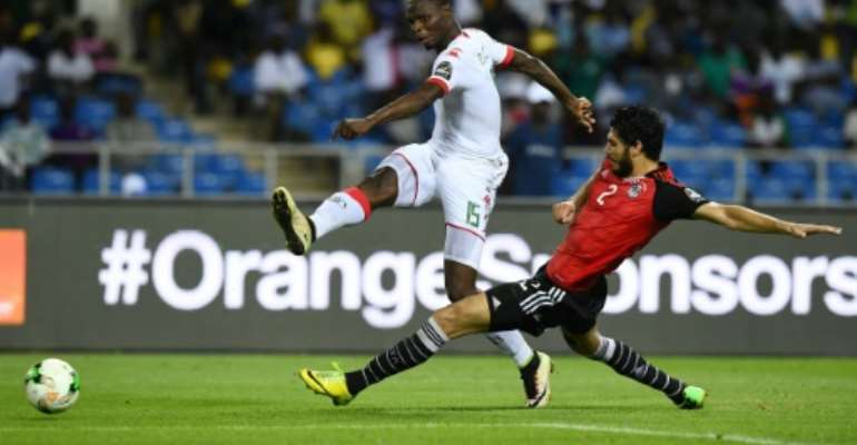 Burkina Faso star Aristide Bance (L) shoots against Egypt in a 2017 Africa Cup of Nations semi-final in Gabon.  By GABRIEL BOUYS (AFP)