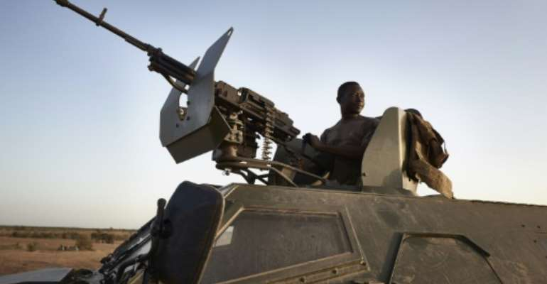 Burkina Faso troops are among those struggling to combat jihadists in the three-border region.  By MICHELE CATTANI (AFP)