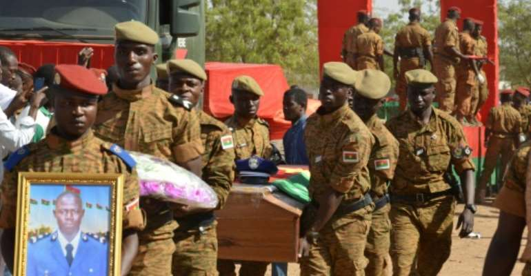 Burkinabe soldiers attend a funeral for eight soldiers killed in twin attacks in the Ouagadougou in March 2018.  By Ahmed OUOBA (AFP/File)