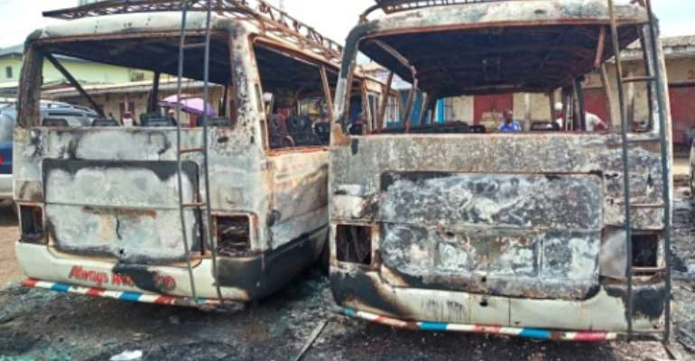 Burned-out buses in Buea, the capital of Cameroon's Southwest Region. The two-year conflict between anglophone separatists and security forces has claimed more than 3,000 lives.  By - (AFP)