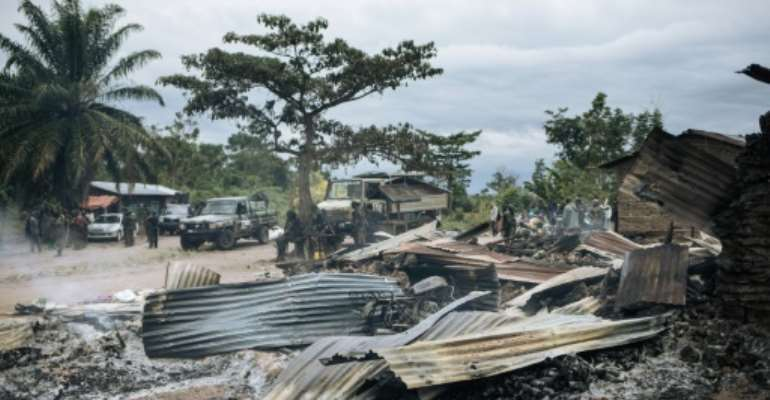 Burnt down houses are seen  in the village of Manzalaho near Beni, Democratic Republic of Congo on February 18, 2020, following an attack  allegedly perpetrated by the rebel group Allied Democratic Forces (ADF).  By Alexis Huguet (AFP/File)