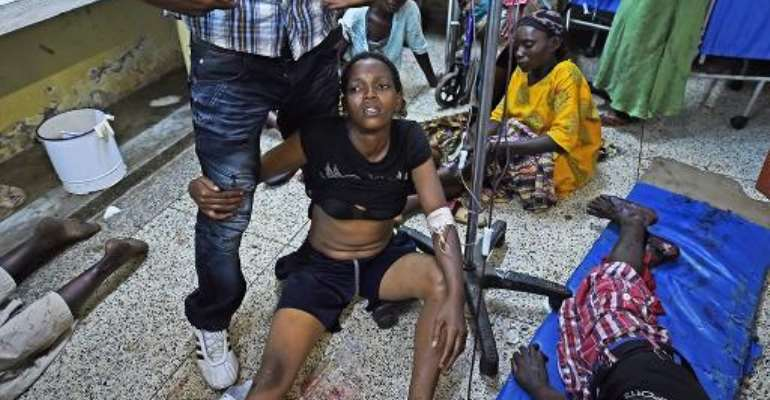 Injured patients at a hospital in Bujumbura on May 22, 2015 after a double grenade attack on a market that killed three people.  By  (AFP)