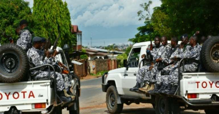 Burundian security forces patrol the streets of Bujumbura in April 2016.  By Onesphore Nibigira (AFP/File)
