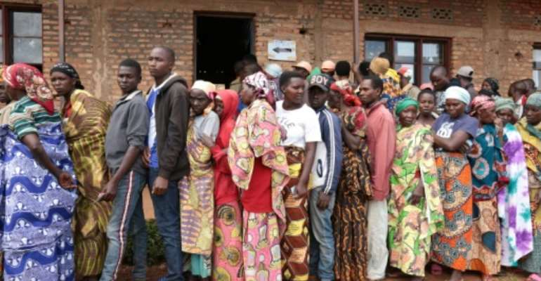 Burundians wait in line to vote in elections at a primary school in Giheta, with little attention paid to social distancing recommendations to curb the COVID-19 coronavirus.  By - (AFP)
