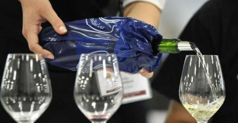 A waiters pours wine during the 2013 Concours Mondial de Bruxelles  in Bratislava, Slovakia on May 10, 2013.  By Samuel Kubani (AFP/File)