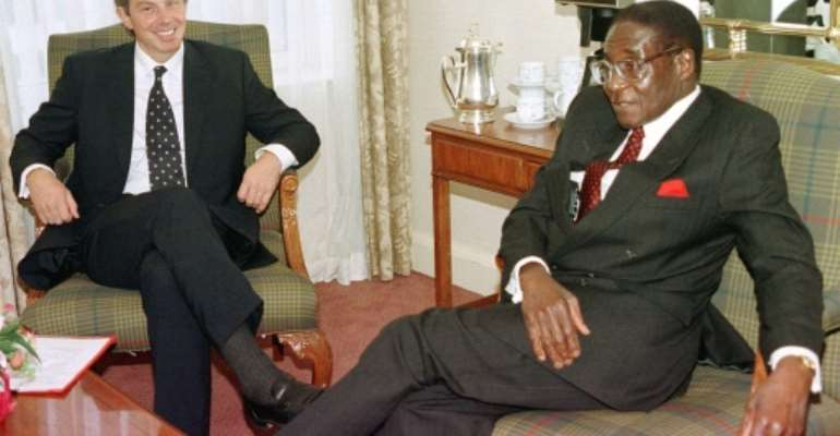 By the late 1990s Western disenchantment with Mugabe's increasingly autocratic style began to grow.  By GERRY PENNY (POOL/AFP/File)
