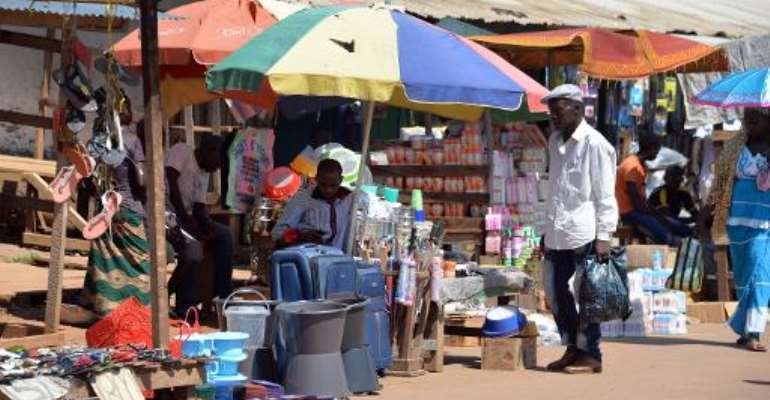 A man walks past a stall in a market in the Central African Republic capital Bangui, on October 2, 2014.  By Pacome Pabamdji (AFP/File)