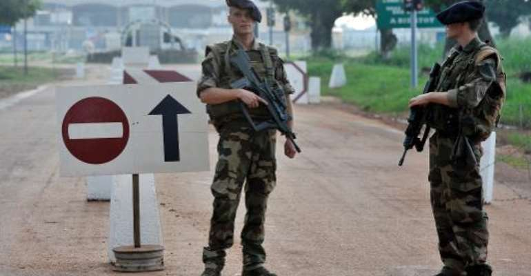 French soldiers stand guard at a checkpoint near Bangui Airport on October 10, 2013.  By Issouf Sanogo (AFP/File)