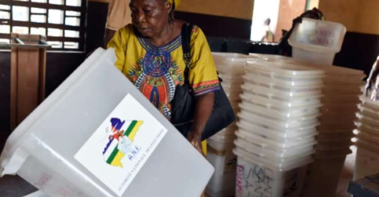 An election worker checks ballot boxes at a polling station in Bangui on December 29, 2015 on the eve of the Central African Republic's presidential and legislative elections.  By Issouf Sanogo (AFP)