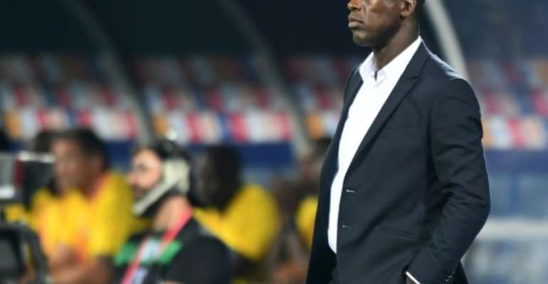 Cameroon coach Clarence Seedorf watches his team draw 0-0 with Ghana in the Africa Cup of Nations in Egypt.  By OZAN KOSE (AFP)
