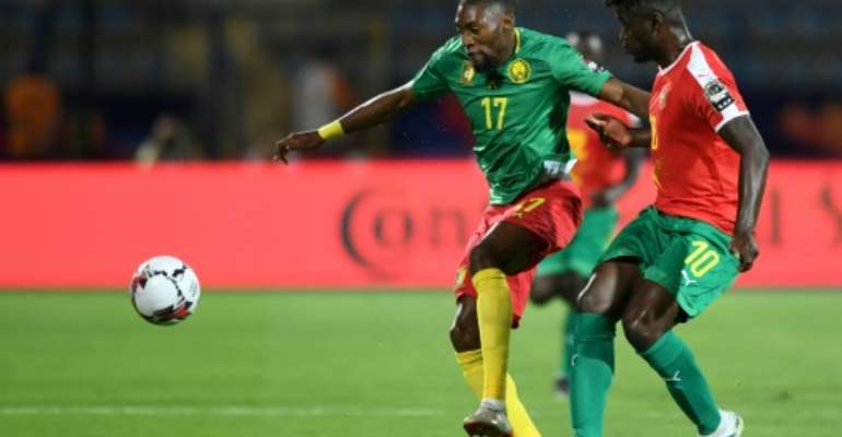 Cameroon forward Karl Toko Ekambi (L) attacks against Guinea-Bissau at the Africa Cup of Nations in Egypt.  By OZAN KOSE (AFP/File)