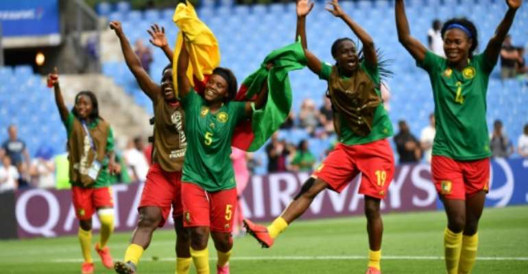 Cameroon players celebrate after Ajara Nchout's last-gasp goal saw them beat New Zealand to qualify for the last 16 of the women's World Cup on Thursday.  By Pascal GUYOT (AFP)