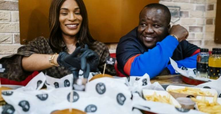 Cameroonian entrepreneur couple Walter and Cindy Tchassem are at the centre of a music and restaurant business empire in Russia.  By Dimitar DILKOFF (AFP)