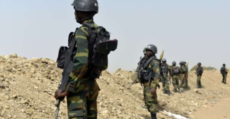 Cameroonian soldiers engaged in the fight against Boko Haram often complain about their conditions.  By Reinnier KAZE (AFP/File)