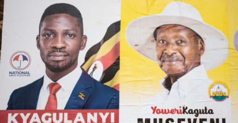 Campaign: Election posters for Bobi Wine, left, and President Yoweri Museveni.  By SUMY SADURNI (AFP)