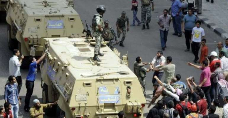 The army deployed troops in central Cairo to quell the clashes.  By  (AFP)