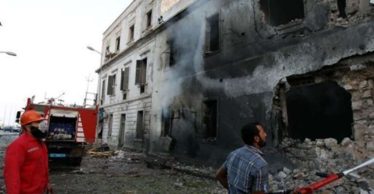 Firefighters extinguish a fire caused by a blast near a foreign ministry building in Benghazi on September 11, 2013.  By Abdullah Doma (AFP)