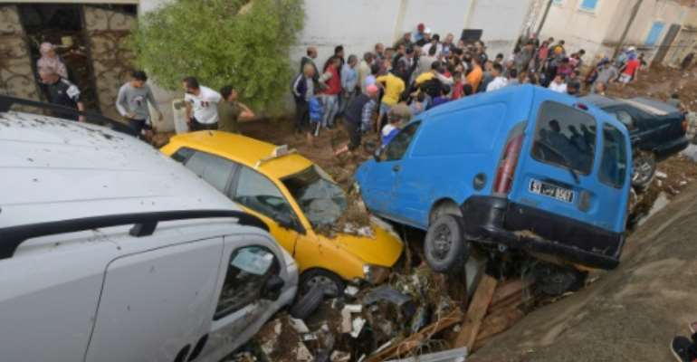 Cars piled up in a street after they were hit by flash floods in the city of Mohamedia near Tunisia's capital Tunis on October 18, 2018.  By FETHI BELAID (AFP)